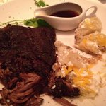 Short rib and pieces of baked potato