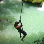 Rope swinging at YS Falls