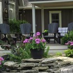 Muskoka Chairs overlooking the Courtyard Koi Pond and more.