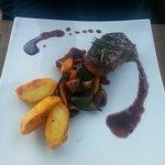 Steak, seasonal vegetables and spicy wedges