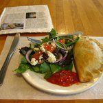 Empanada, salad, and magazine