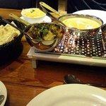 garlic naan, chicken tikka bhuna, korma, pilau rice and potatos and spinach