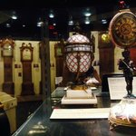 French serpent & egg clock; large case grandfathers in the background