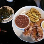 Chicken tenders, wood grilled squash, pintos, and turnip greens