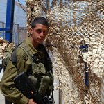 A young IDF soldier guarding the border crossing to Lebanon