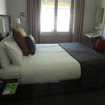 Heritage suite bedroom - with washbasin, dressing room with desk, ironing board, bathrobe, slipp