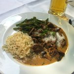 Pork with mushrooms, rice and beans