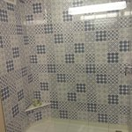 Large tiled shower, but not good place to hold soap