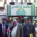 Entrance of the restaurant with Pakistani and Jordanian hosts