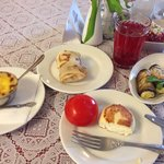 Mushrooms with cream and cheese, salted tomato, syrnik, aubergines with cheese