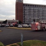 Employee threw cigarette butt in trash can which set off fire alarm at 6:03am and evacuated the