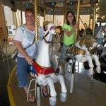Enjoying a carousel ride.
