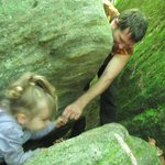Gerry helping his three-year-old, Gabby, through the rocks.