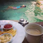 Snack, beverage, and pool in front of the room
