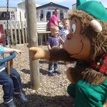 Meeting cheeky monkey at playpark