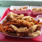 Gator, fish, grilled shrimp, hush puppies,  and sweet potato fries