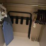Wardrobe, iron and ironing board