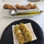 Bread and olive oil. Lemon and oilve madelines.