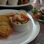 Battered snapper with chips, seafood mix and a greek salad.