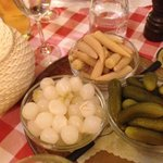 Potatoes in basket, cornichons etc for the raclette