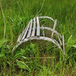 Old wooden lobster trap on shore