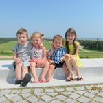 my kids posing from the top of the hill