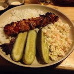Meat kebab, pickled cucumbers, rice and coleslaw