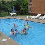 Grandchildren in the pool with their Dad.