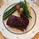 Flank steak entree - done to perfection with beautifully arranged side dishes.