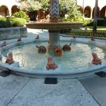 A fountain surrounded by frogs?  One is the mark....