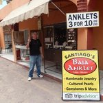 Santiago, the jeweller outside his shop
