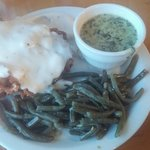 Chicken fried steak with overcooked mushy green beans