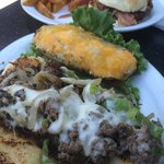 Philly cheesesteak, twice baked potato, BBQ cheeseburger, and steak fries