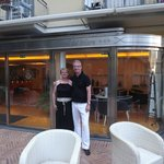Me and my husband at the entrance to the hotel