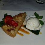 Almond tort with vanilla ice cream