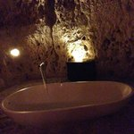 Free standing bathtub in cave