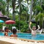 Pool and kids playing