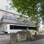 A coach tour bus outside the hotel - too much reliance of tours?