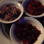 Three different condiments for the crispy duck from light, medium to high spiciness.