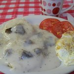 my fav breakfast/ hot coffee, biscuit with sausage gravy, fried egg and sliced tomato