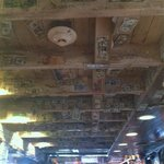 Ceiling full of dollar bills