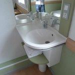 Basin in corner of room