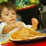 Pancakes bigger than he is