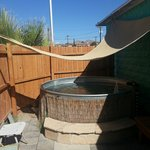 Your private tub, under the stars with a removable canopy for daytime shade, and chairs/benches
