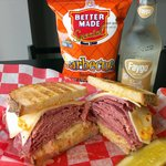 #4 CLASSIC REUBEN - House-cooked Sy Ginsberg Corned Beef w/ Swiss, kraut & Russian on grilled ry