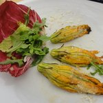 Part of the stuffed fried zucchini flowers plate