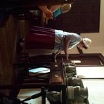 waitress at sideboard. Pewter water pitchers, early american furniture
