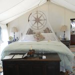 Bed inside glamping tent