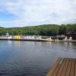 Beach and docks with lots of loungers and Muskoka chairs