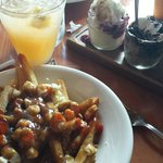 Poutine with the banana split trio both were very good the dessert is a definite must try servic